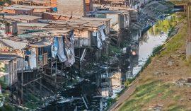 Favela close to Alphaville, São Paulo, Brazil; photo by Wilfredor on Wikimedia
